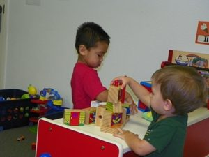kids playing wooden toys